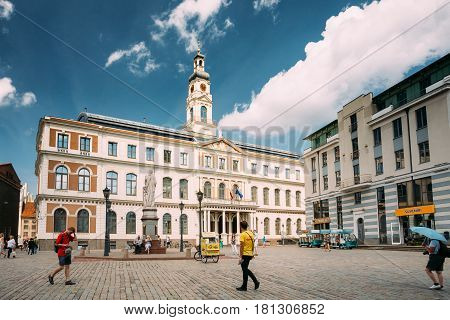 Riga, Latvia - July 2, 2016: People Walking Near Famous Landmark - Old Riga City Hall In Sunny Summer Day.