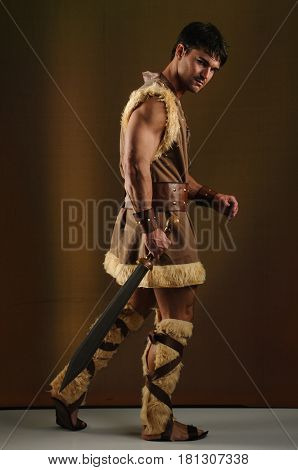 The obedient caveman awaits his lady for love.