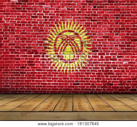 Kyrgyzstan flag painted on brick wall with wooden floor