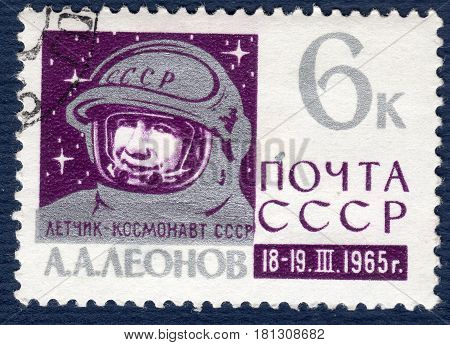 USSR - CIRCA 1965: Postage stamp printed in USSR shows portrait of cosmonaut Alexei Leonov, the first one came out In open space, from the series