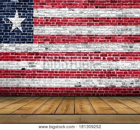 Liberia flag painted on brick wall with wooden floor