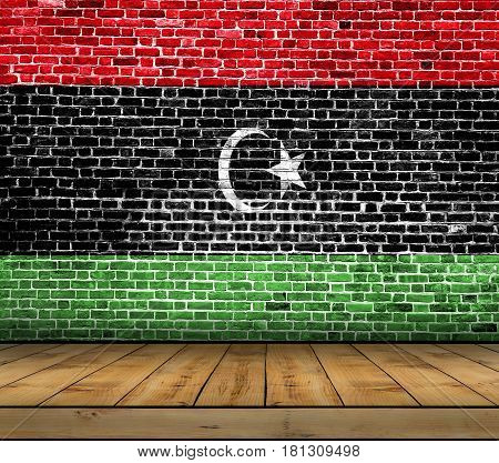 Libya flag painted on brick wall with wooden floor