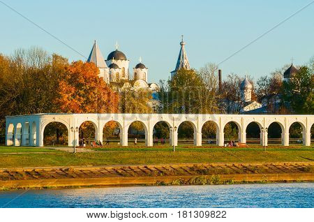 Veliky Novgorod, Russia - architecture view. Arcade of Yaroslav Courtyard and ancient St Nicholas cathedral in Veliky Novgorod Russia