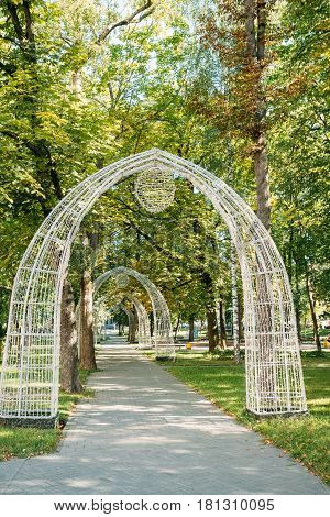 Gomel, Belarus. Decorative Arches In The Pioneer Square On Sovetskaya Street In A Summer Sunny Day.