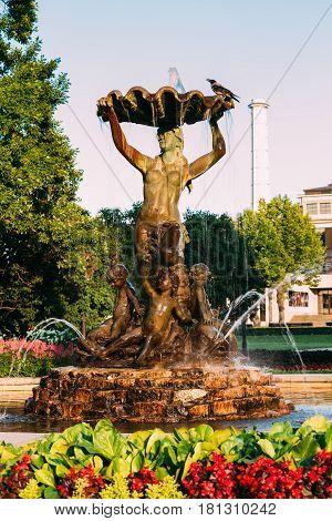 Riga, Latvia. Fountain Nymph In Water Splashes In Aspazijas Boulevard Near National Opera House.