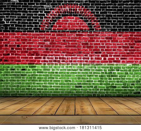Malawi flag painted on brick wall with wooden floor