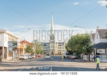GRAAFF REINET SOUTH AFRICA - MARCH 23 2017: A street scene in Graaff Reinet with the Dutch Reformed Church built 1885-1887 in the back