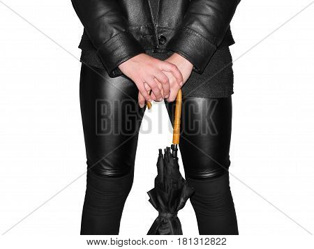 part of feminine body in leather cloth with umbrella in hand