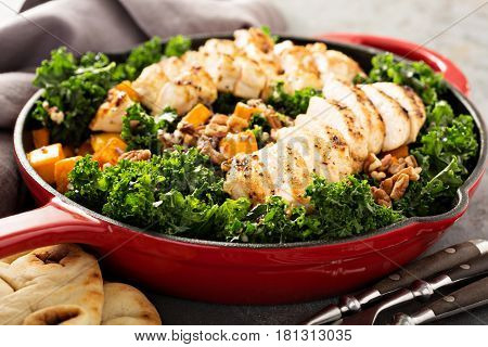 Healthy and quick dinner with grilled chicken, quinoa, kale and butternut squash
