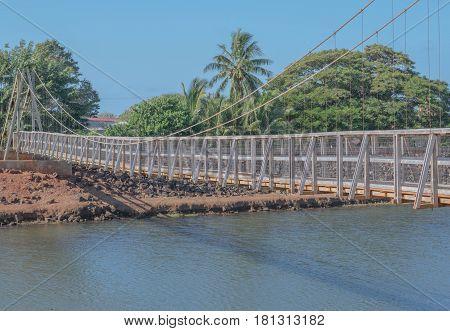 Swinging in Hanapepe: the historic swinging bridge in Old Hanapepe Town, on Kauai, Hawaii, mid morning, March 28, 2017