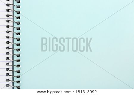 blank page of spiral notebook closeup for messages