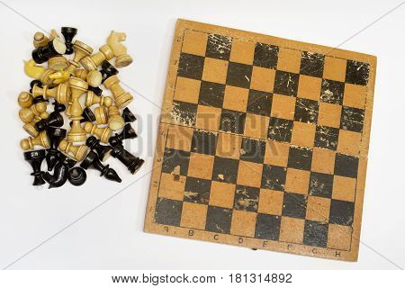 Set Of Chess Pieces And A Chessboard