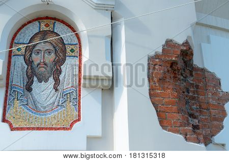 The image of Christ on the wall next to the bare brick.