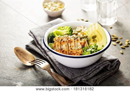 Grain and grilled chicken bowl for lunch with pearl barley, avocado and broccoli