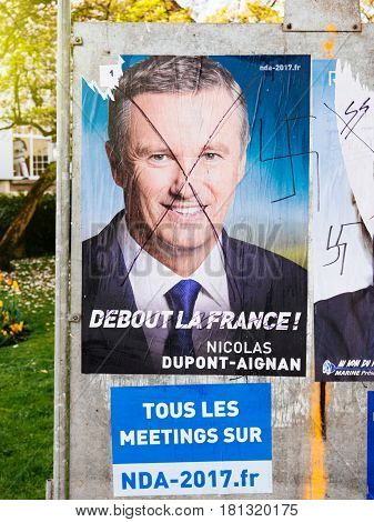 STRASBOURG FRANCE - APR 12 2017: Official campaign posters of Nicolas Dupont-Aignan political party leader of Debout la France (DLF) ones of the eleven candidates running in the 2017 French presidential election