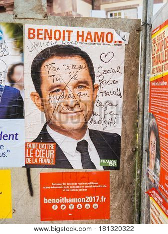 STRASBOURG FRANCE - APR 12 2017: Official campaign posters of Benoit Hamonpolitical party leader of Parti socialiste (PS) ones of the eleven candidates running in the 2017 French presidential election