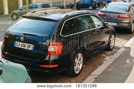 STRASBOURG FRANCE - APR 8 2017: Rear view of black new Skoda Octavia wagon car parked on the crowded street