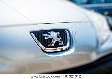STRASBOURG FRANCE - APR 8 2017: Lion logotype of new Peugeot car manufacturer in blue technological colorcast. Peugeot is one of the bigest car manufacturer in the world