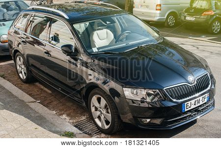 STRASBOURG FRANCE - APR 8 2017: Front view of black new Skoda Octavia wagon car parked on the crowded street