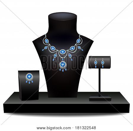 Necklace with sapphires, brooch and earrings on mannequins