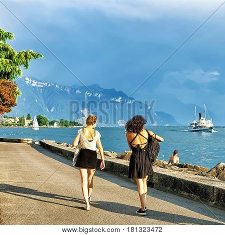 Vevey, Switzerland - August 30, 2016: Young girls at the embankment on Geneva Lake in Vevey Vaud canton Switzerland