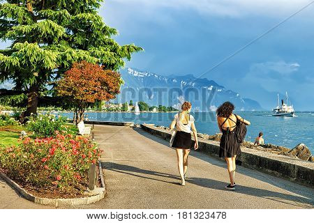 Vevey, Switzerland - August 30, 2016: Young girls at the embankment at Geneva Lake in Vevey Vaud canton Switzerland