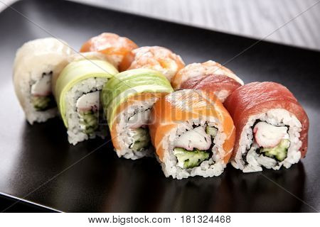 Sushi roll assortment on black plate