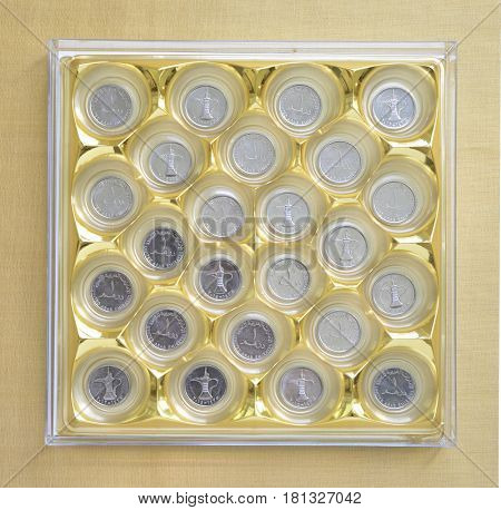 One UAE Dirham coins placed in a chocolate box. Concept for 'choice for financial products'.