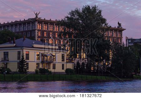 Building with the Griffons on the roof on the Bank of the Neva river at sunset.