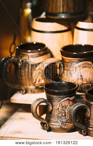 Tallinn Estonia - December 2 2016: Souvenir Beer Cup On Store Shelves. Various Traditional Earthenware Pottery Tableware Cups At Folk Market. Souvenir From Tallinn Estonia.