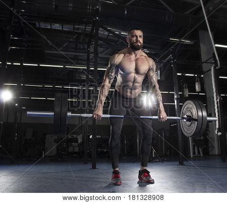 Attractive Muscular Bodybuilder Doing  Deadlifts In Modern Gym.c