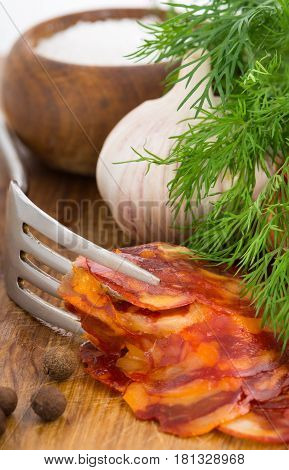 Rustic Still Life With A Slice Of Sausage