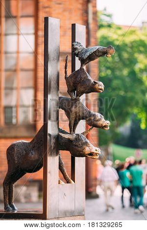 Riga Latvia - July 1, 2016: Bronze statue depicting the Bremen Town Musicians located in Riga Latvia. Famous Landmark. Travel Destination