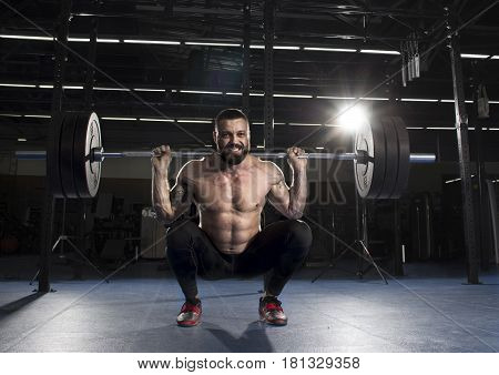 Muscular Sportsman Doing The Squat Exercise In The Gym.functiona