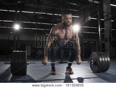 Attractive Muscular Bodybuilder Doing  Deadlifts In Modern Gym.f