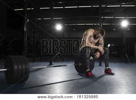 Attractive Muscular Shirtless Athlete Taking The Break From Heav