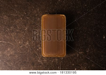 Tar soap on a dark marble background. Personal Hygiene care.