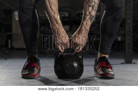 Closeup Of Fitness Man Doing A Weight Training By Lifting A Heav