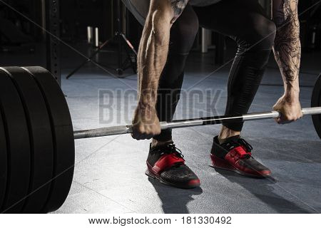 Closeup Of Attractive Muscular Bodybuilder Preparing To Do  Dead