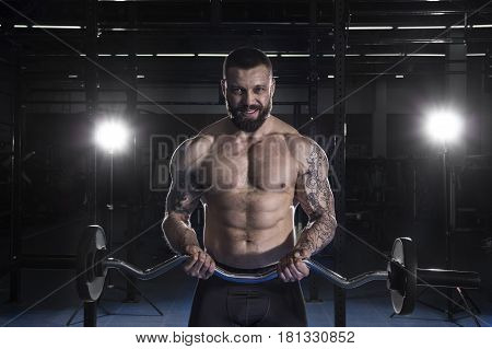 Muscular  Man Doing Heavy Weight Exercise For Biceps With Barbel