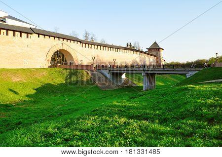 Veliky Novgorod Kremlin towers and viaduct over the moat in Veliky Novgorod Russia - architecture sunset landscape