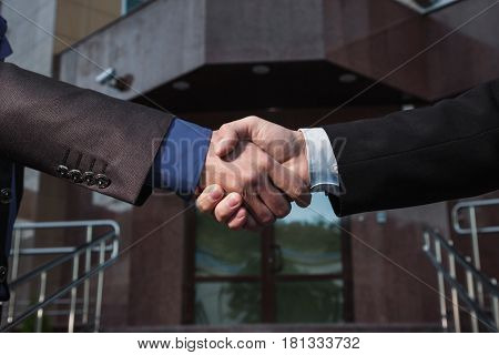 Business agreement cooperation. Handshake on background Bank. Shake hands with each other. Friendship cooperation partners. Cooperation concept.