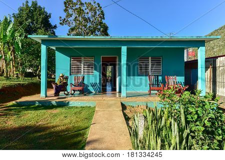 Vinales Cuba - January 11 2017: Local cuban man sitting in front of his house in Vinales Cuba.