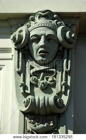 ZAGREB, CROATIA - SEPTEMBER 14: Architectural detail with a mascaron of a young woman set on top of a column on the facade of an old building, Zagreb, Croatia on September 14, 2013.