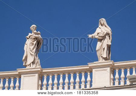 ROME, ITALY - SEPTEMBER 02: St. Agatha and St. Elizabeth of Portugal, colonnade of St. Peters Basilica - the world largest church, is the center of Christianity in Rome, Italy on September 02, 2016.