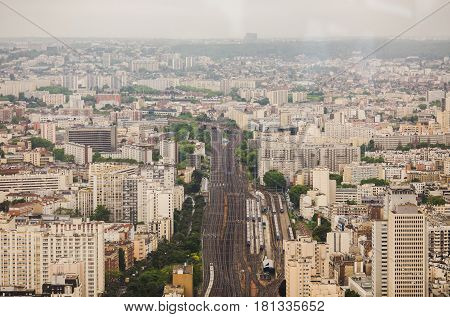 View of the streets of Paris from the heights. Travel through Europe. Attractions in France. Cloudy Paris. Clouds in the sky. A wide street. A street in a big city.