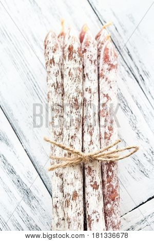 Fuet Sausages On The Wooden Background
