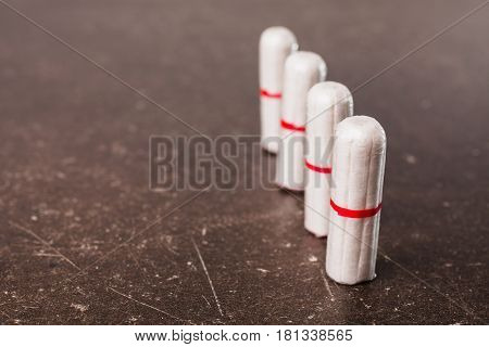 Female white tampon on a dark marble background. Hygiene. Woman tampon concept