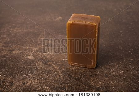 Tar soap on a dark marble background. Personal care. Hygiene. Soap on table. Soap concept