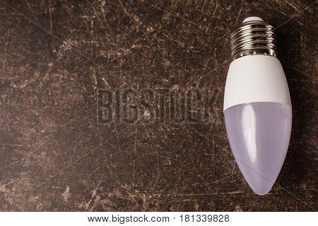 Conceptual idea with LED light bulb on a dark marble background. To save energy. Eco concept idea. New idea